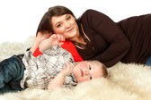 Smiling mother lying with her son — Stock Photo