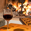Stock Photo: Red wine and fireplace
