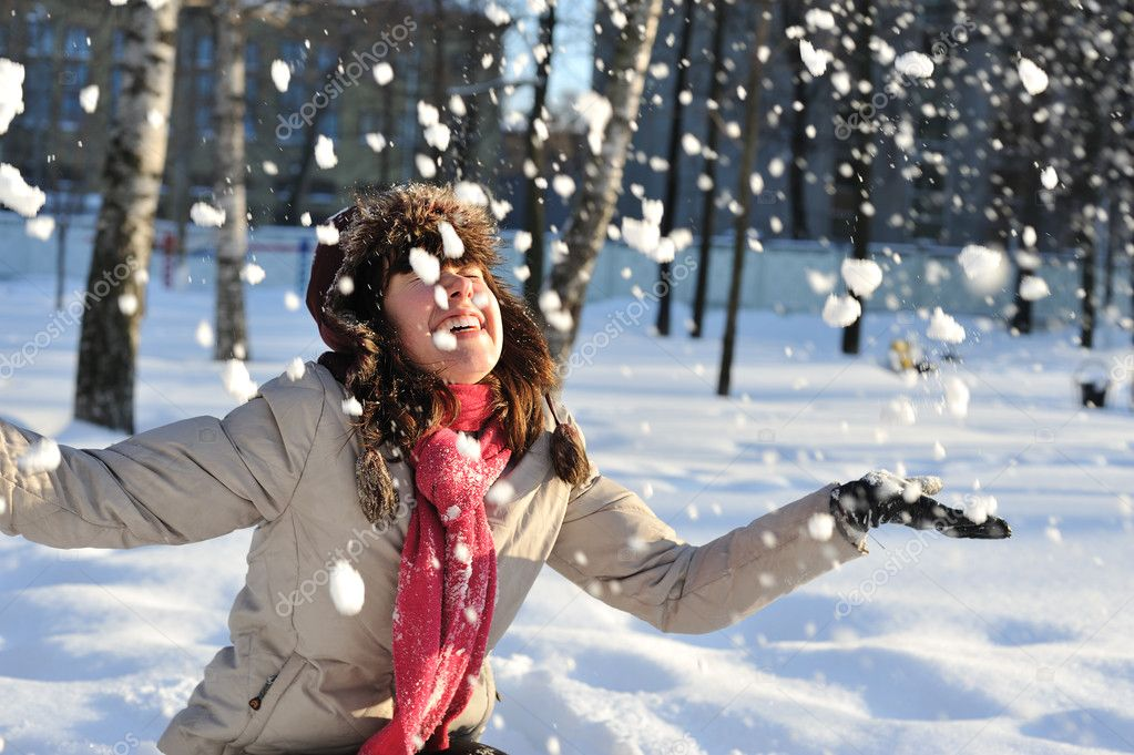 Funny  teenager  girl playing in deep  snow — Stock Photo #2416868