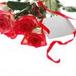Bouquet of roses with greeting card — Stock Photo