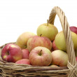 Apples in woven basket — Stock Photo
