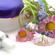 Stock Photo: Cosmetic cream with flowers