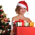Girl with christmas present — Stock Photo