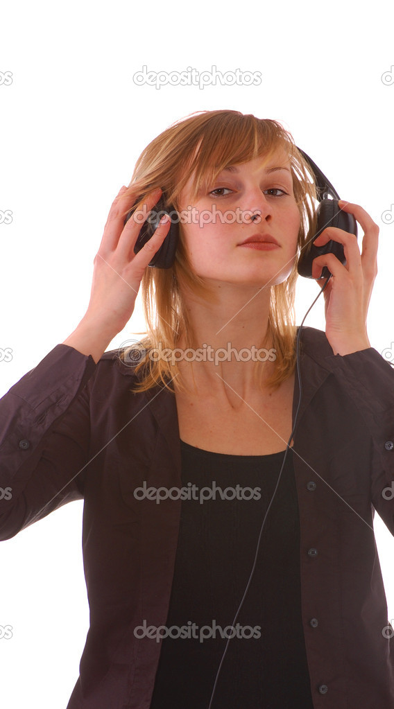 Blond girl  teenager with headphones listens to musik — Stock Photo #2565579