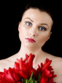 Woman with red tulips — Stock Photo