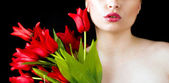 Red lips and tulips — Stock Photo