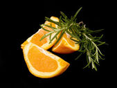 Three pieces of orange and rosemary — Stock Photo