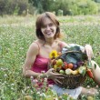 Stock Photo: Girl with a basket full of vegetables