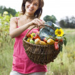 Girl with a basket full of vegetables — Stock Photo