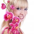 Young blond girl with pink orchid — Stock Photo #2511467