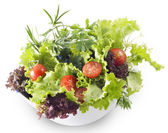 Mixed greens with cherry tomatoes — Stock Photo