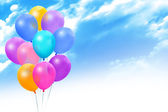 Colored balloons on blue sky — Stock Photo