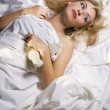 Girl with plush toy in bed — Stock Photo