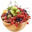 Mixed berries in wooden bowl — Stock Photo