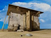 Small house in desert — Stock Photo