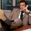 Businessman talking on telephone — Foto de Stock