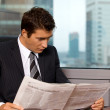 Stock Photo: Businessmreading newspaper