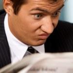 Businessman reading newspaper — Stock Photo #2419069