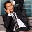 Businessman using telephone — Stock Photo