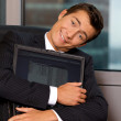 Businessman embracing laptop — Stock Photo