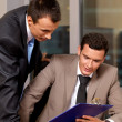 Businessmen working in office - Stock Photo
