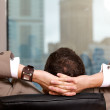 Stock Photo: Businessmrelaxing in office