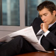 Businessmreading newspaper — Stock Photo #2419288