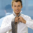 Royalty-Free Stock Photo: Portrait of businessman tying tie