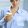 Businesswoman holding coffee — Stock Photo