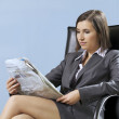Stock Photo: Businesswomreading newspaper