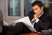 Businessman reading newspaper — Stock Photo