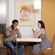 Stock Photo: Young couple drinking tefor breakfast