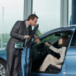 Car salesperson explaining car features to custo — Stock Photo #2432558