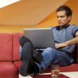 Young man using laptop - Stock Photo