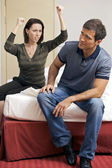 Young arguing with her husband in hotel room — Stock Photo