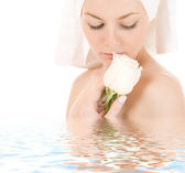 Woman in white towel — Stock Photo