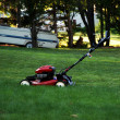 Lawnmower on the grass — Stock Photo