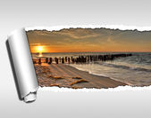 Torn rolled ripped paper, beach holidays — Stock Photo
