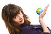 Young woman holds the globe — Stock Photo