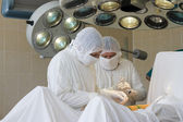 Surgeon team at work — Stock Photo