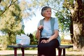 Old Laydy on a bench, — Stock Photo