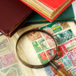 Stock Photo: Magnifying glass and postage stamps