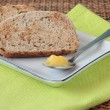Sliced wholemeal bread and ghee — Stock Photo