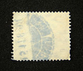 Blank postage stamp with postmark — Stock Photo