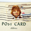 USA postage stamp on postcard - Stock Photo
