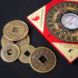 Stock Photo: Feng shui compass and chinese coins.