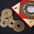 Feng shui compass and chinese coins. - Stock Photo