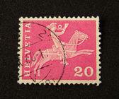 Helvetia postage stamp — Stock Photo