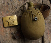 Army belt and water bottle — Stock Photo