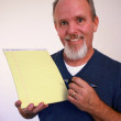Man with notepad — Stock Photo
